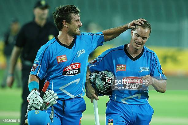 Nathan Reardon and Michael Klinger of Adelaide celebrates after the Big Bash League match between the Adelaide Strikers and the Perth Scorchers at...