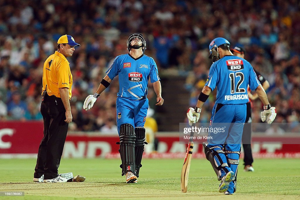Nathan Reardon (C) of Adelaide reacts after he got hit by the ball during the Big Bash League match between the Adelaide Strikers and the Perth Scorchers at Adelaide Oval on January 10, 2013 in Adelaide, Australia.