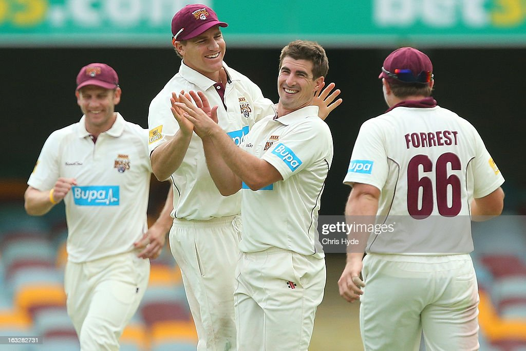 Nathan Reardon of the Bulls celebrates with team mates after dismissing Tim Paine of the Tigers during day one of the Sheffield Shield match between the Queensland Bulls and the Tasmanian Tigers at The Gabba on March 7, 2013 in Brisbane, Australia.