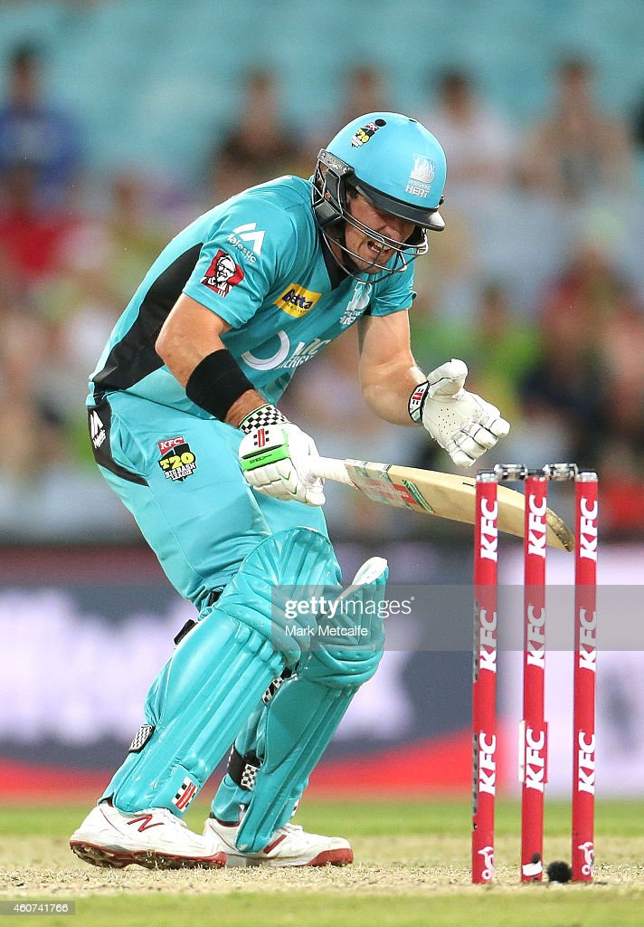 Nathan Reardon of the Heat reacts after being struck in the head by a delivery during the Big Bash League match between the Sydney Thunder and Brisbane Heat at ANZ Stadium on December 21, 2014 in Sydney, Australia.