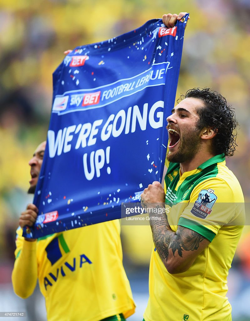 Nathan Redmond (L) and Bradley Johnson of Norwich City celebrate promotion after the Sky Bet Championship Playoff Final between Middlesbrough and Norwich City at Wembley Stadium on May 25, 2015 in London, England. Norwich City seal promotion to the Premier League with a 2-0 victory