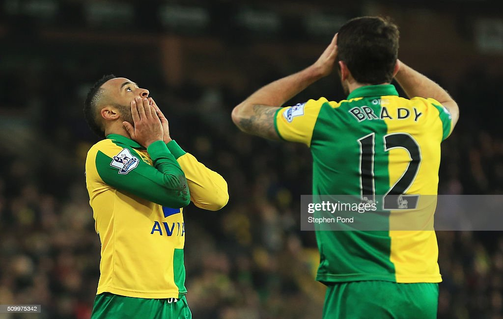 Nathan Redmond and Robbie Brady of Norwich City react after their 22 draw in the Barclays Premier League match between Norwich City and West Ham...