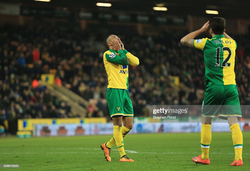Nathan Redmond (L) and Robbie Brady (R) of Norwich City react after their 2-2 draw in the Barclays Premier League match between Norwich City and West Ham United at Carrow Road on February 13, 2016 in Norwich, England.