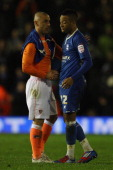 Nathan Redmond of Birmingham City is consoled by Kevin Phillips of Blackpool after the 22 draw saw Blackpool qualify for the final during the npower...