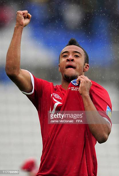 Nathan Redmond of England celebrates winning the penalty shoot out during the FIFA U17 World Cup round of 16 match between England and Argentina at...