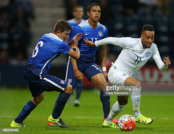 Nathan Redmond of England gets away from Wil Trapp of USA during the International friendly match between England U21 and USA U23 at Deepdale on...