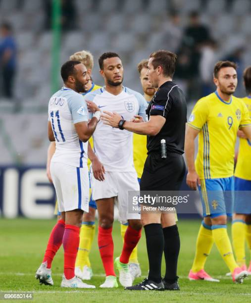 Nathan Redmond of England in discussion with Tobias Stieler referee after the UEFA European Under21 Championship match between Sweden and England at...