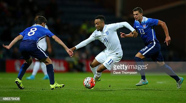 Nathan Redmond of England makes his way between Emerson Hyndman of USA left and Marc Pelosi of USA during the International friendly match between...