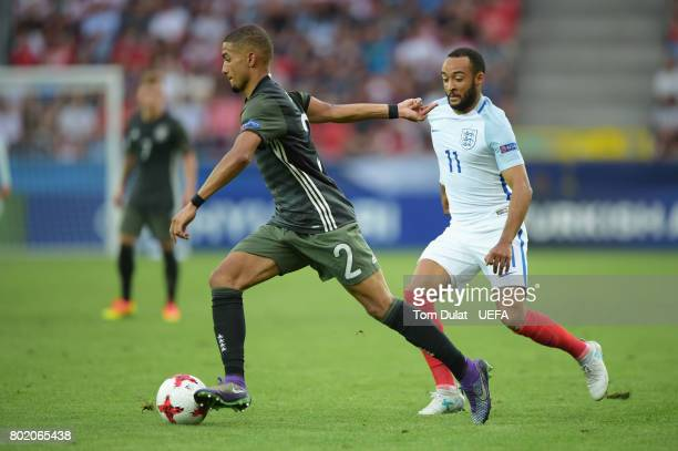 Nathan Redmond of England puts pressure on Jeremy Toljan of Germany during the UEFA European Under21 Championship Semi Final match between England...