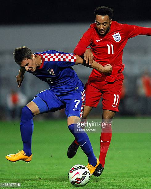 Nathan Redmond of England vies with Marko Pjaca of Croatia during the UEFA U21 Championship Playoff Second Leg match between Croatia and England at...