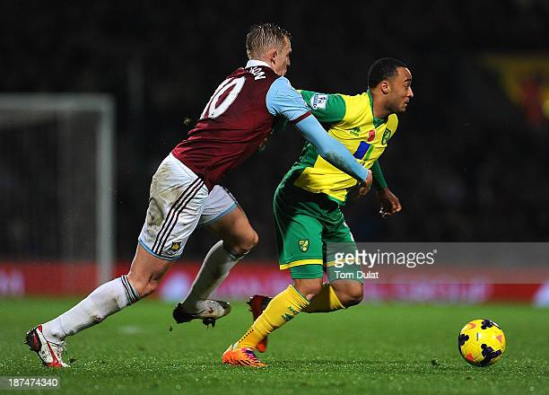 Nathan Redmond of Norwich City and Jack Collison of West Ham United in action during the Barclays Premier League match between Norwich City and West...