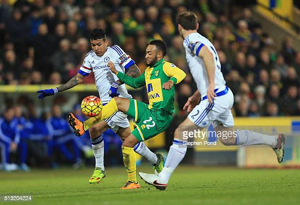 Nathan Redmond of Norwich City and Kenedy of Chelsea compete for the ball during the Barclays Premier League match between Norwich City and Chelsea...