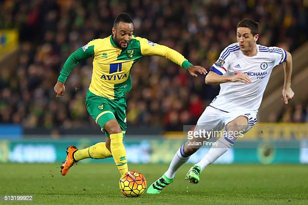 Nathan Redmond of Norwich City and Nemanja Matic of Chelsea compete for the ball during the Barclays Premier League match between Norwich City and...