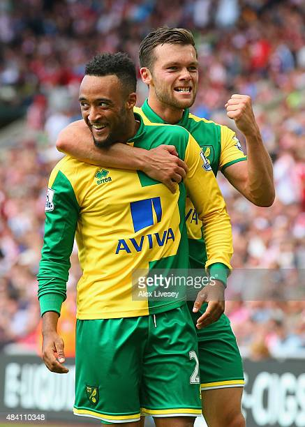 Nathan Redmond of Norwich City celeberates scoring his team's third goal with his team mates Jonathan Howson during the Barclays Premier League match...