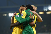 Nathan Redmond of Norwich City congratulates Dieumerci Mbokani of Norwich City after he scored their fourth goal during the Barclays Premier League...
