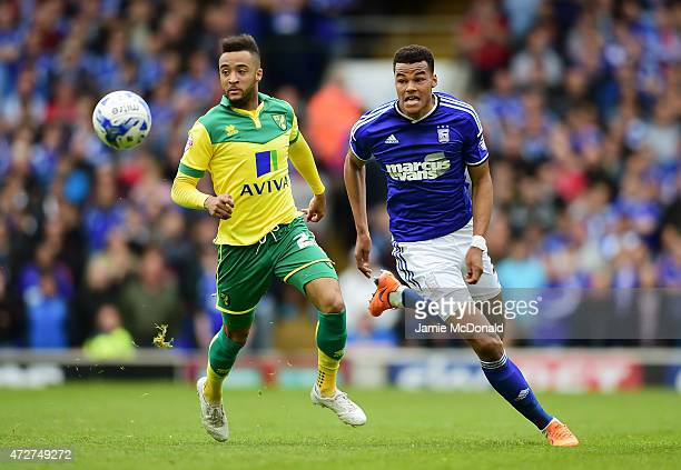 Nathan Redmond of Norwich closes down Tyrone Mings of Ipswich during the Sky Bet Championship Playoff semifinal first leg match between Ipswich Town...