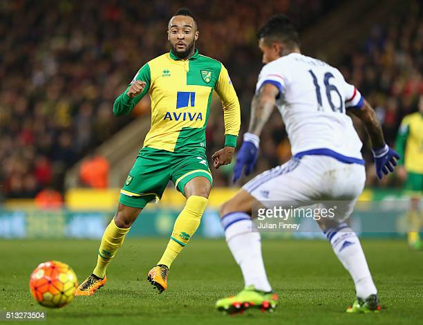 Nathan Redmond of Norwich goes past Kenedy of Chelsea during the Barclays Premier League match between Norwich City and Chelsea at Carrow Road on...