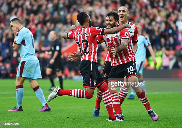 Nathan Redmond of Southampton celebrates with team mates Charlie Austin and Oriol Romeu as he scores their second goal during the Premier League...