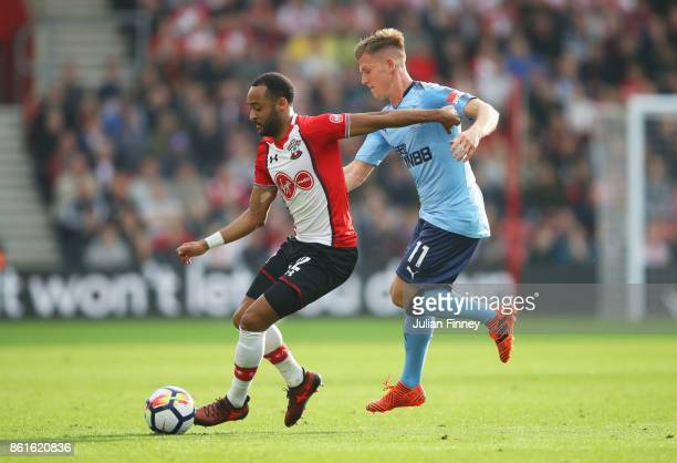 Nathan Redmond of Southampton evades Matt Ritchie of Newcastle United during the Premier League match between Southampton and Newcastle United at St...