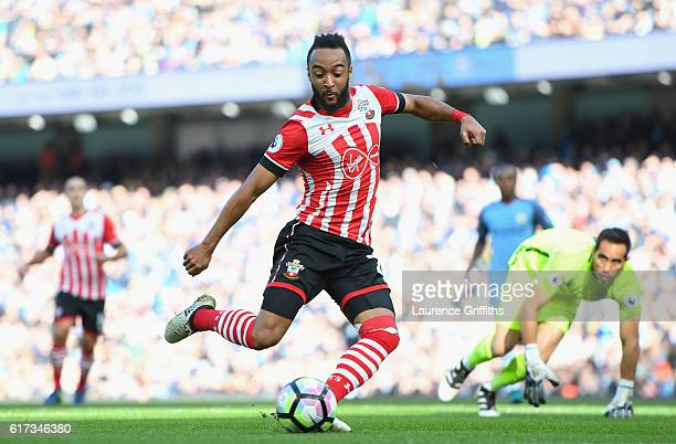 Nathan Redmond of Southampton scores the opening goal during the Premier League match between Manchester City and Southampton at Etihad Stadium on...