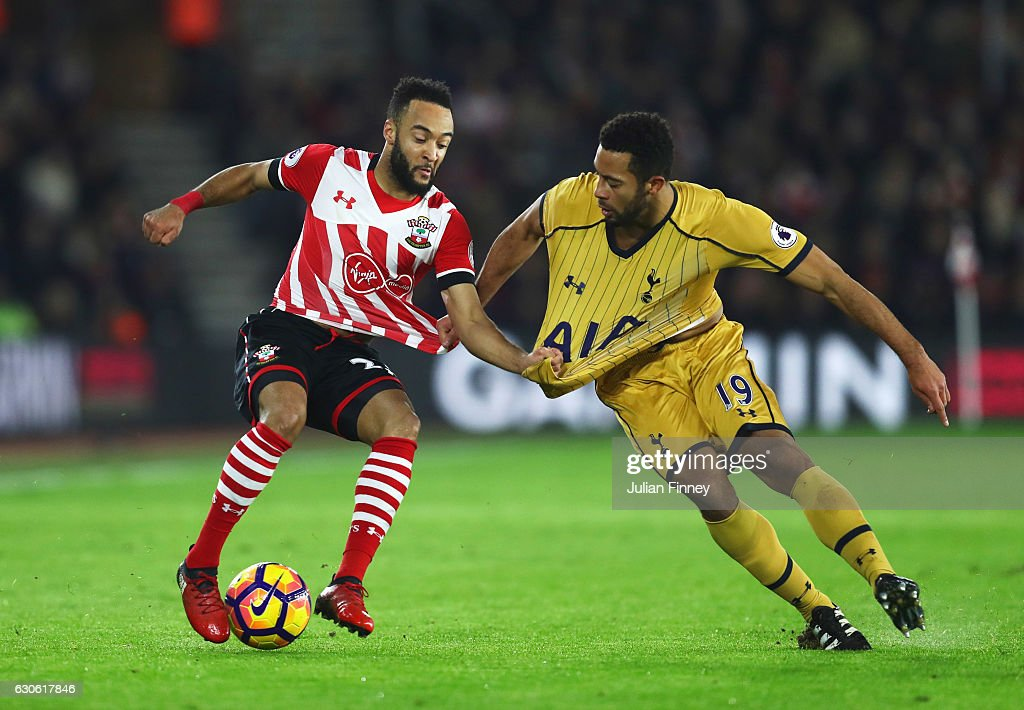 Nathan Redmond of Southampton tangles with Mousa Dembele of Tottenham Hotspur during the Premier League match between Southampton and Tottenham Hotspur at St Mary's Stadium on December 28, 2016 in Southampton, England.