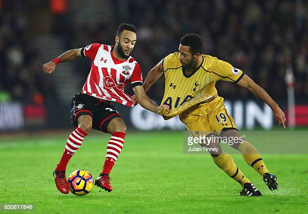Nathan Redmond of Southampton tangles with Mousa Dembele of Tottenham Hotspur during the Premier League match between Southampton and Tottenham...
