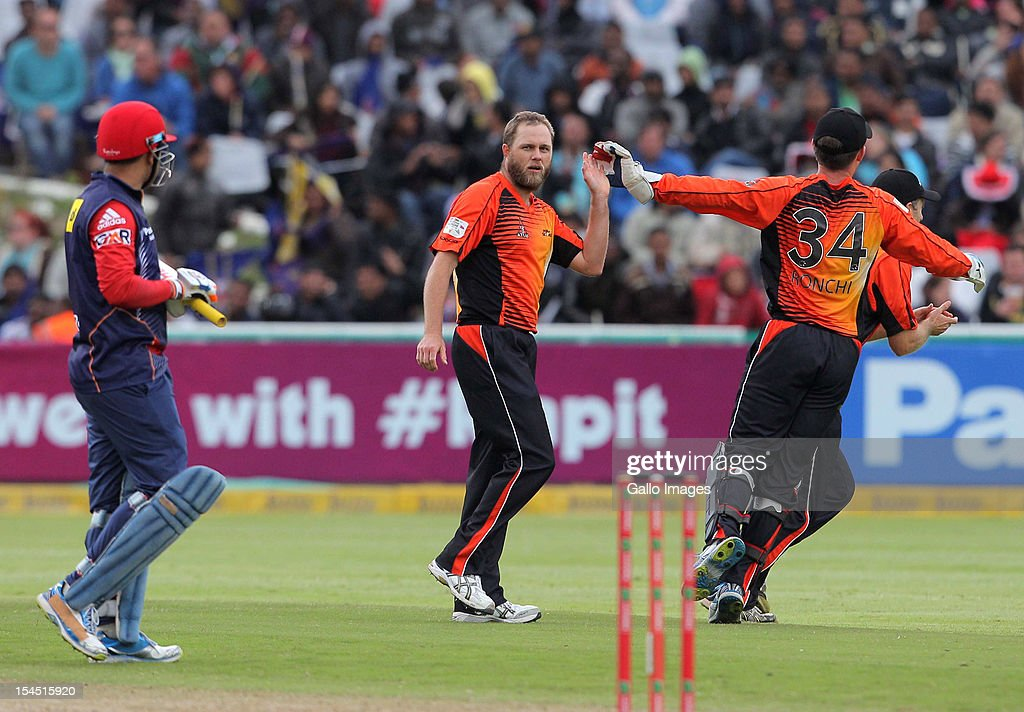 Nathan Rimmington of Perth Scorchers celebrates with <a gi-track='captionPersonalityLinkClicked' href=/galleries/search?phrase=Luke+Ronchi&family=editorial&specificpeople=724790 ng-click='$event.stopPropagation()'>Luke Ronchi</a> the wicket of Virender Sehwag during the Champions league twenty20 match between Perth Scorchers and Delhi Daredevils at Sahara Park Newlands on October 21, 2012 in Cape Town, South Africa.