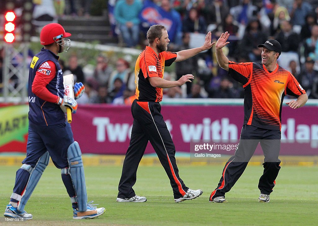 Nathan Rimmington of Perth Scorchers celebrates with Simon Katich of Perth Scorchers the wicket of Virender Sehwag during the Champions league twenty20 match between Perth Scorchers and Delhi Daredevils at Sahara Park Newlands on October 21, 2012 in Cape Town, South Africa.