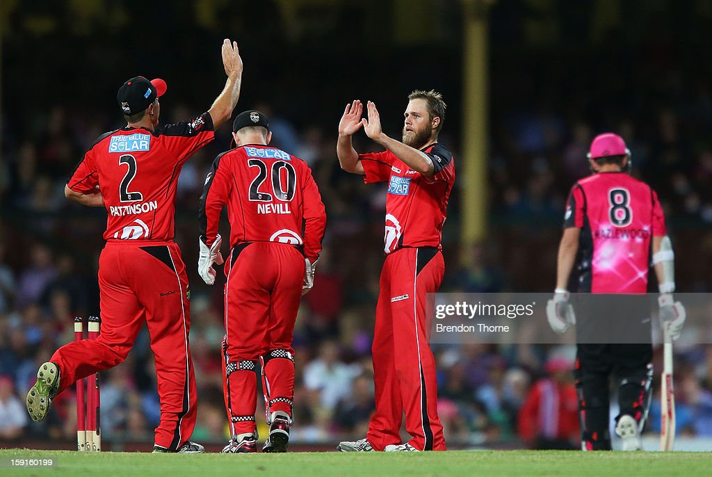 Nathan Rimmington of the Renegades celebrates with team mates after claiming the wicket of Josh Hazelwood of the Sixers during the Big Bash League match between the Sydney Sixers and the Melbourne Renegades at SCG on January 9, 2013 in Sydney, Australia.