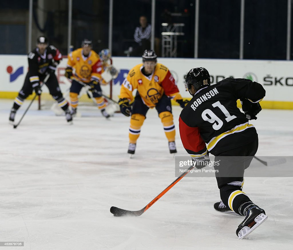 Nathan Robinson #91 of Nottinham Panthers prepared to shoot during the Champions Hockey League group stage game at the National Ice Centre in Nottingham, between Nottingham Panthers and Lukko Rauma on August 22, 2014 in Nottingham, United Kingdom.