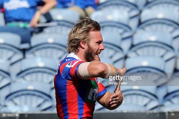 Nathan Ross of the Knights celebrates a try during the round two NRL match between the Newcastle Knights and the Gold Coast Titans at McDonald Jones...