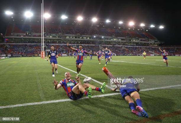 Nathan Ross of the Knights celebrates after scoring a try during the round six NRL match between the Newcastle Knights and the Canterbury Bulldogs at...