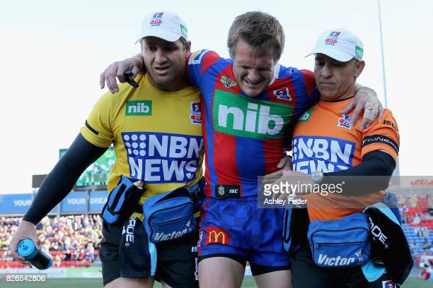Nathan Ross of the Knights is carried off injured during the round 22 NRL match between the Newcastle Knights and the New Zealand Warriors at...