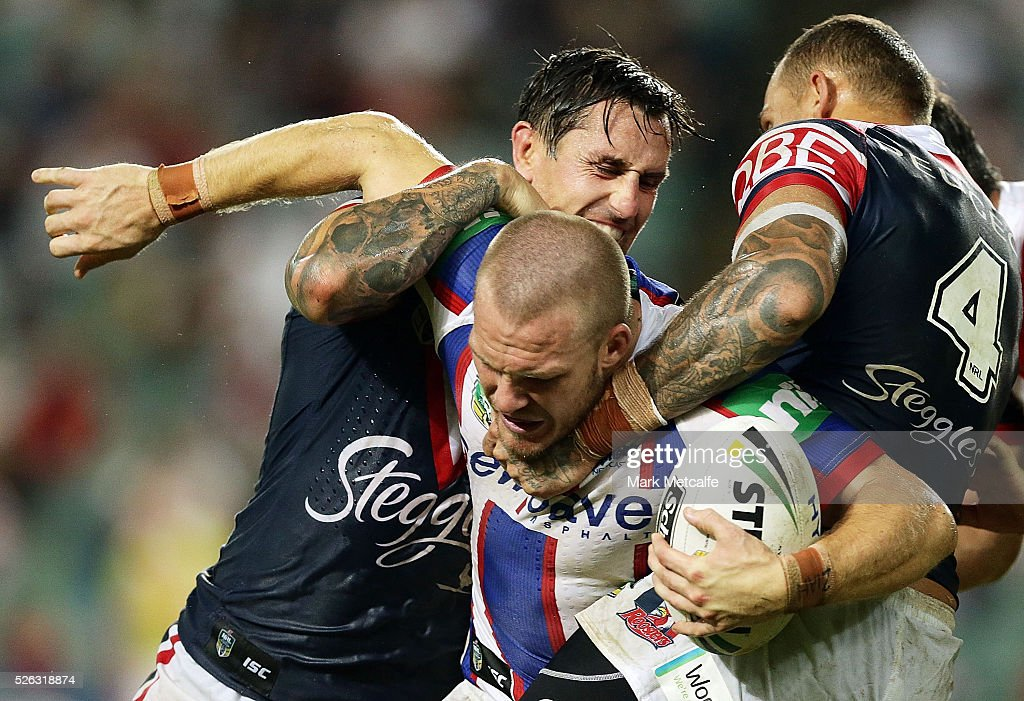 Nathan Ross of the Knights is tackled by <a gi-track='captionPersonalityLinkClicked' href=/galleries/search?phrase=Mitchell+Pearce&family=editorial&specificpeople=4208962 ng-click='$event.stopPropagation()'>Mitchell Pearce</a> of the Roosters and <a gi-track='captionPersonalityLinkClicked' href=/galleries/search?phrase=Blake+Ferguson+-+Rugby+Player&family=editorial&specificpeople=11188731 ng-click='$event.stopPropagation()'>Blake Ferguson</a> of the Roosters during the round nine NRL match between the Sydney Roosters and the Newcastle Knights at Allianz Stadium on April 30, 2016 in Sydney, Australia.