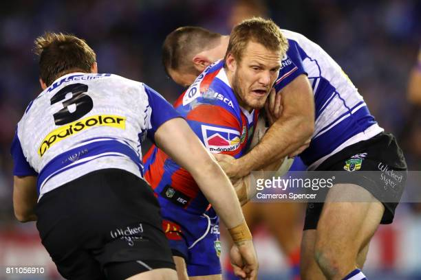 Nathan Ross of the Knights is tackled during the round 18 NRL match between the Canterbury Bulldogs and the Newcastle Knights at Belmore Sports...