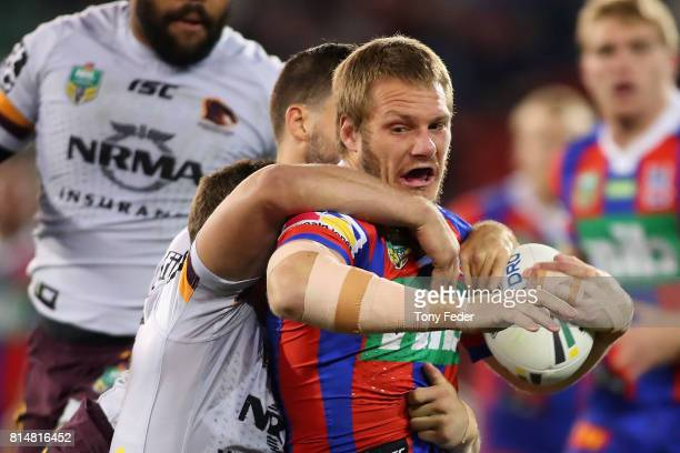 Nathan Ross of the Knights is tackled during the round 19 NRL match between the Newcastle Knights and the Brisbane Broncos at McDonald Jones Stadium...