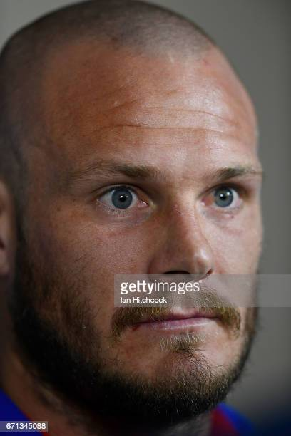 Nathan Ross of the Knights looks on during a pre match television interview before the round eight NRL match between the North Queensland Cowboys and...