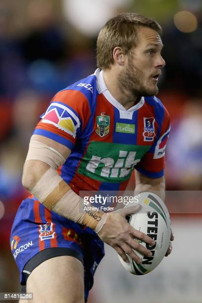 Nathan Ross of the Knights runs the ball during the round 19 NRL match between the Newcastle Knights and the Brisbane Broncos at McDonald Jones...