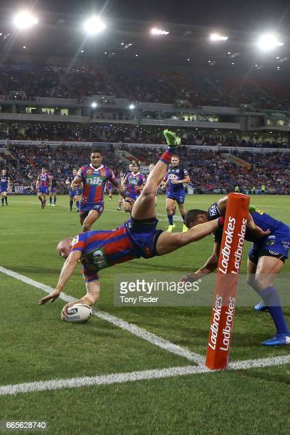 Nathan Ross of the Knights scores a try during the round six NRL match between the Newcastle Knights and the Canterbury Bulldogs at McDonald Jones...