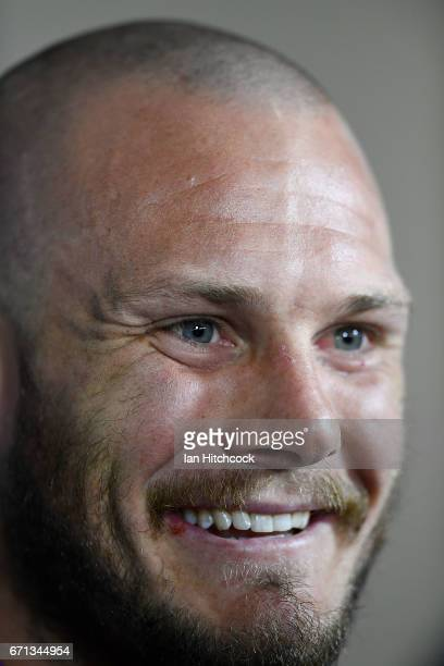 Nathan Ross of the Knights smiles during a pre match television interview before the round eight NRL match between the North Queensland Cowboys and...