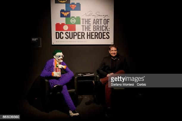 Nathan Sawaya poses next to Joker one of the works exhibited and realized with 10881 Lego bricks during it the 'The Art of the Brick DC Super Heroes'...