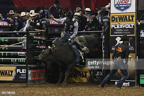 Nathan Schaper rides during the 2017 Professional Bull Riders Monster Energy Buck Off At The Garden at Madison Square Garden on January 7 2017 in New...