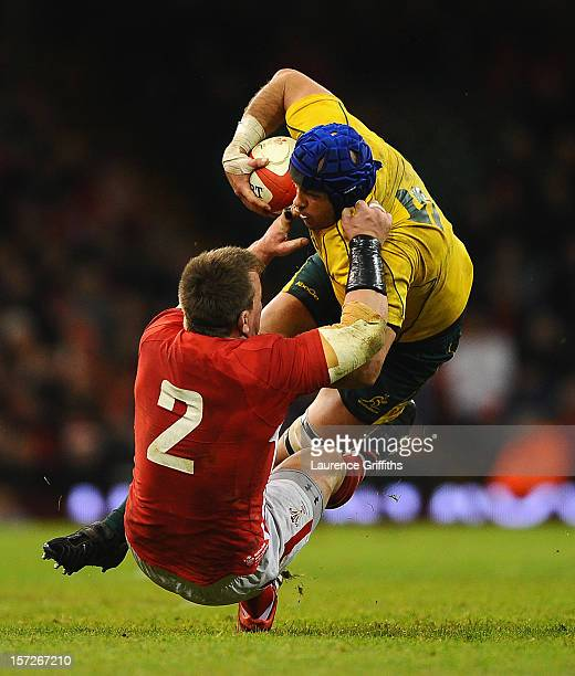 Nathan Sharpe of Australia is tackled by Matthew Rees of Wales during the International match between Wales and Australia at Millennium Stadium on...