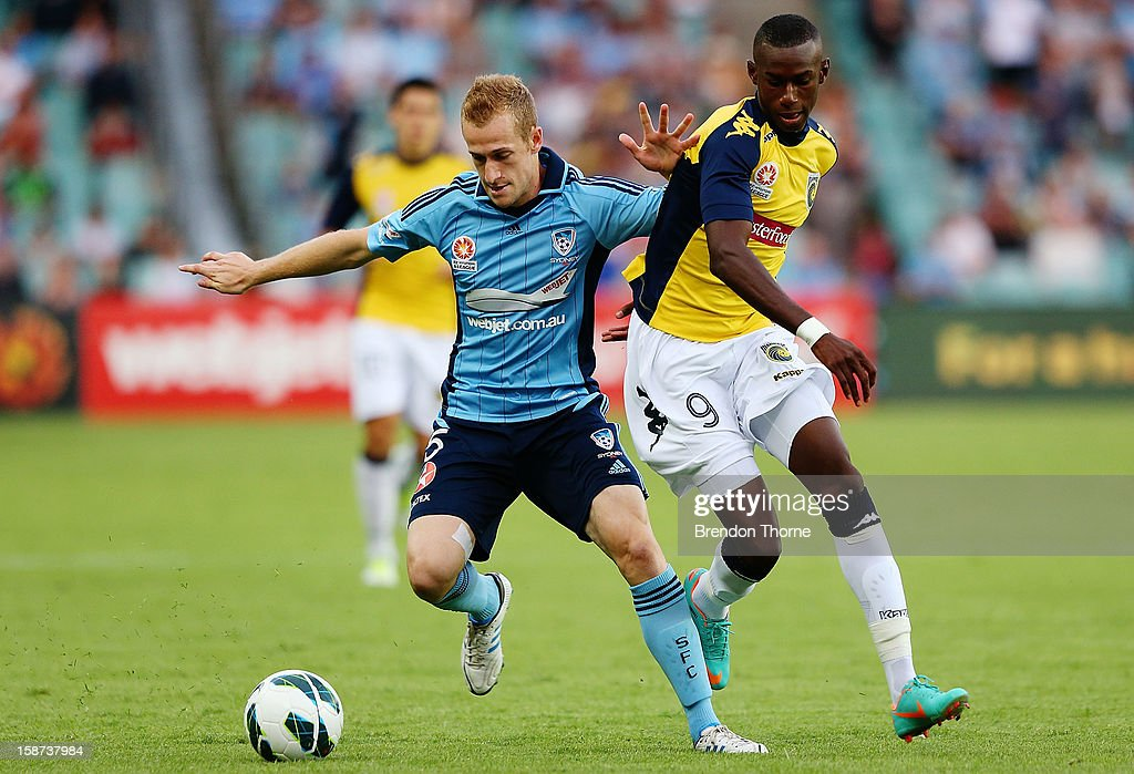 Nathan Sherlock of Sydney competes with Bernie Ibini of the Mariners during the round 13 A-League match between Sydney FC and the Central Coast Mariners at Allianz Stadium on December 27, 2012 in Sydney, Australia.