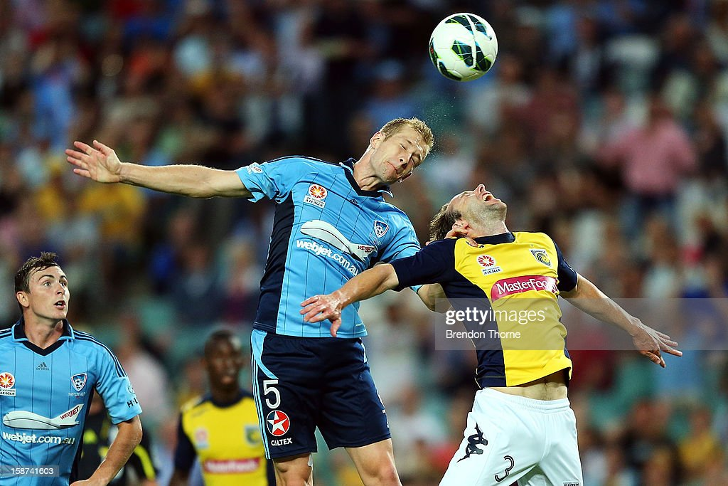 Nathan Sherlock of Sydney competes with Joshua Rose of the Mariners during the round 13 A-League match between Sydney FC and the Central Coast Mariners at Allianz Stadium on December 27, 2012 in Sydney, Australia.