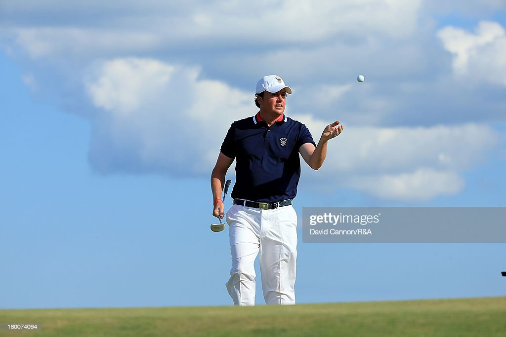 Nathan Smith of the United States is thrown his ball as he secured the winning point by beating Kimsey 4 and 3 during the final day afternoon singles matches of the 2013 Walker Cup Match at The National Golf Links of America on September 8, 2013 in Southampton, New York.