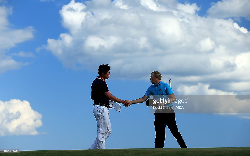 Nathan Smith of the United States team shakes hands with Nathan Kimsey of England and the Great Britain and Ireland team as Smith secured the winning point by beating Kimsey 4 and 3 during the final day afternoon singles matches of the 2013 Walker Cup Match at The National Golf Links of America on September 8, 2013 in Southampton, New York.