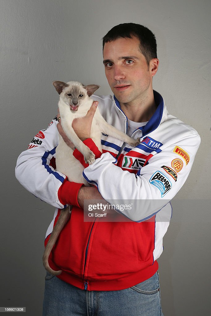 Nathan Smith poses for a photograph with his Caramel Point Siamese cat named 'Prince Soloman' after being exhibited at the Governing Council of the Cat Fancy's 'Supreme Championship Cat Show' held in the NEC on November 24, 2012 in Birmingham, England. The one-day Supreme Cat Show is one of the largest cat fancy competitions in Europe with over one thousand cats being exhibited. Exhibitors aim to have their cat named as the show's 'Supreme Exhibit' from the winners of the individual categories of: Persian, Semi-Longhair, British, Foreign, Burmese, Oriental, Siamese.