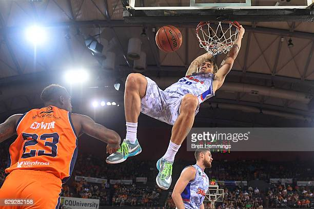 Nathan Sobey of the 36ers dunks the ball during the round 10 NBL match between the Cairns Taipans and the Adelaide 36ers at Cairns Convention Centre...