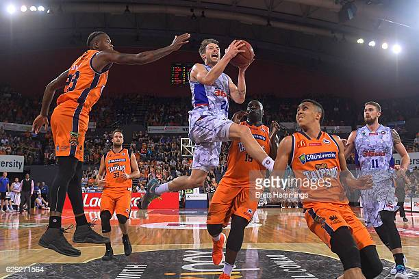 /Nathan Sobey of the 36ers lays up a shot under pressure during the round 10 NBL match between the Cairns Taipans and the Adelaide 36ers at Cairns...